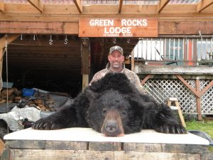 hunter with black bear